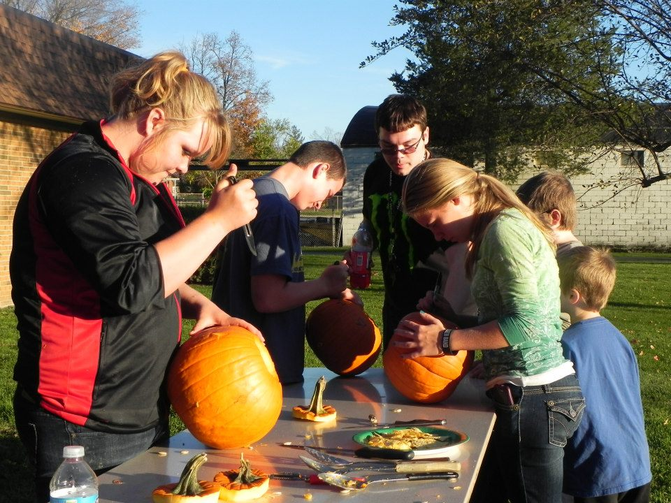 youth group carving pumpkins